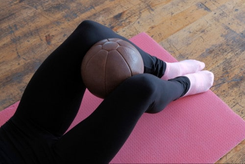 Exercise Your Thighs by Clamping Your Knees into Your Legs